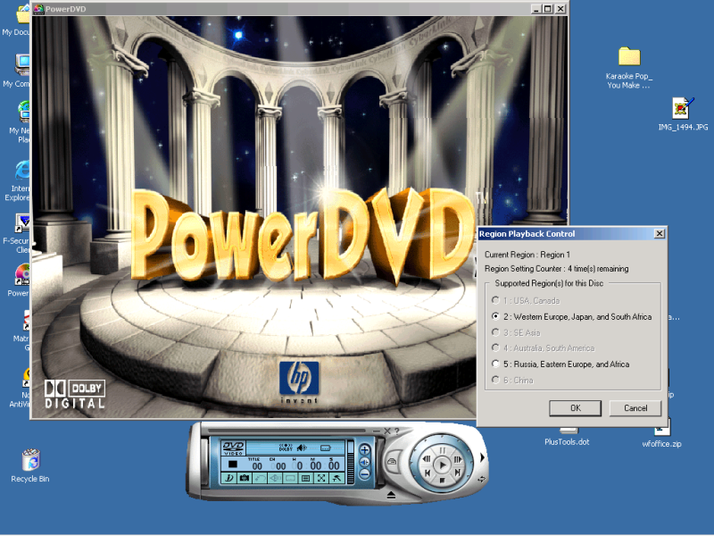 "Screenshot of a PowerDVD window on the Windows 2000 platform along with the ""Region Playback Control"" dialog box that appears after insertion into the DVD drive of a DVD disk that has a region code different from the one specified when the software was installed or last changed."