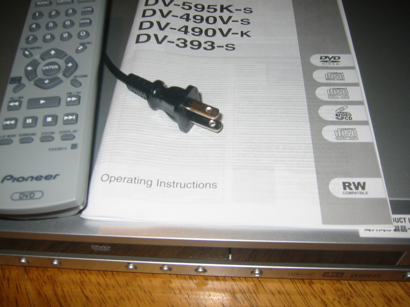 "Picture of a ""region-free"" Pioneer DV-393-s DVD player, which is able to play DVDs having any region code and is compatible with typical North American video equipment. This one even has a North American plug."
