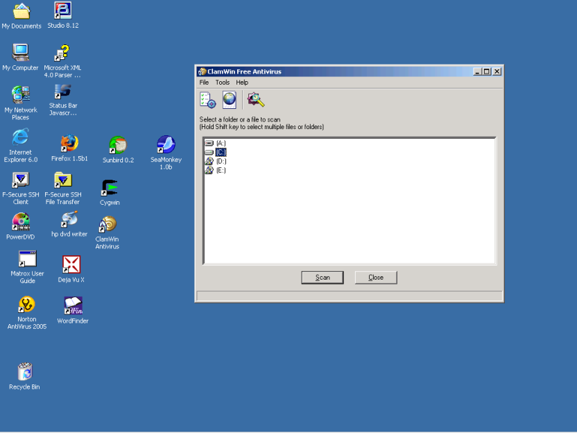 Screen shot showing ClamWin application window on a Windows 2000 desktop showing the A:, C:, D: and E: drives represented by icons.